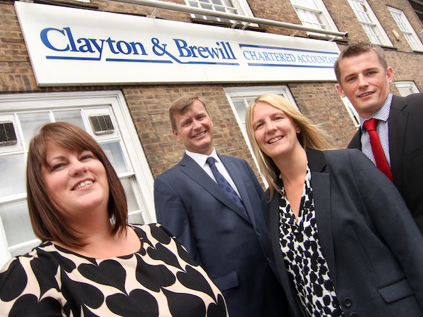 Julie Braithwaite (left) with head of payroll Chloe Hughes, and partners Neil South and Doug Perry.
